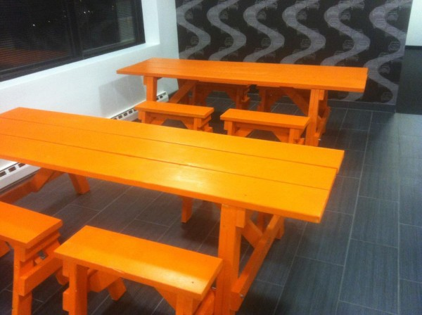 orange picnic benches